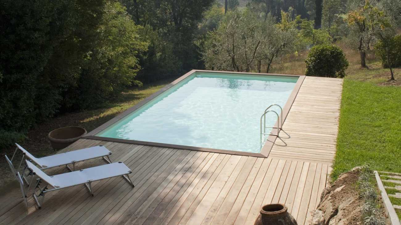 the aboveground pool is simply surrounded by a deck wood or other materials enclosing the pool in the structure and therefore making it look like a